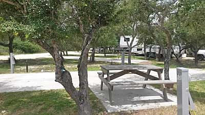 Large RV sites at Enchanted Oaks RV Park in Rockport, TX