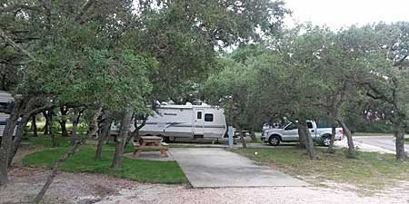 Rv sites in the trees at Enchanted Oaks RV Park in Rockport, TX